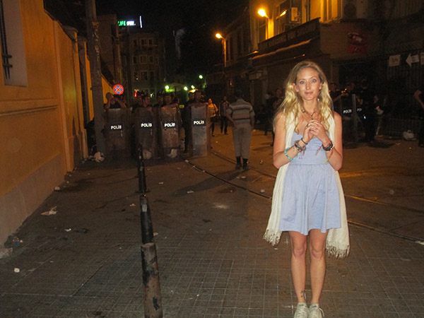 24 - Riots were taking place in Taxim Square. Grace Abbott stops for a quick flick. photo jzsm